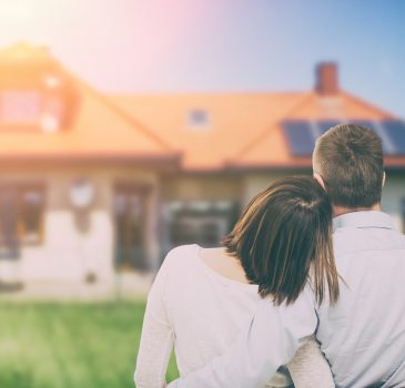 Young couple looking at dream house.